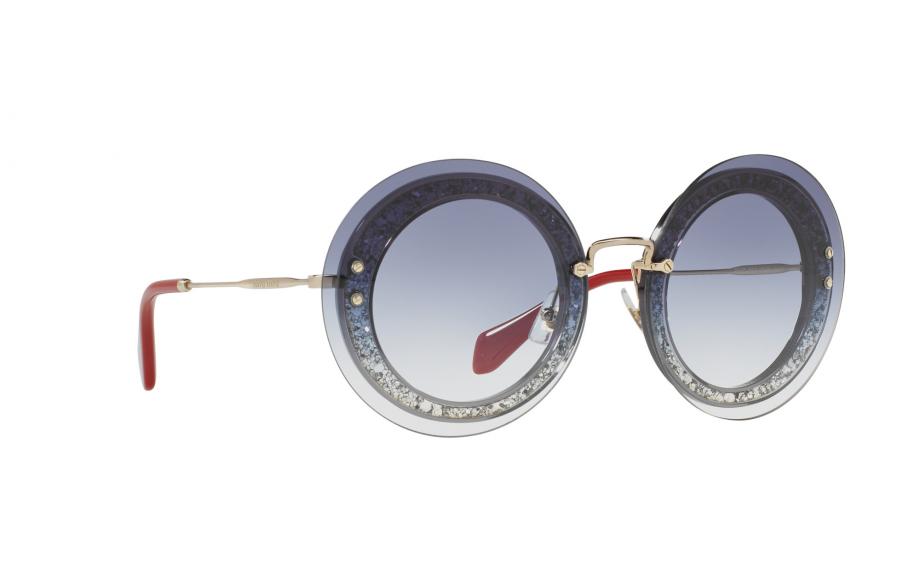 5eb91b39a389 Miu Miu MU10RS Sunglasses. zoom. 360° view. Frame: Transparent blue with  gold arms. Lens: Graduated blue