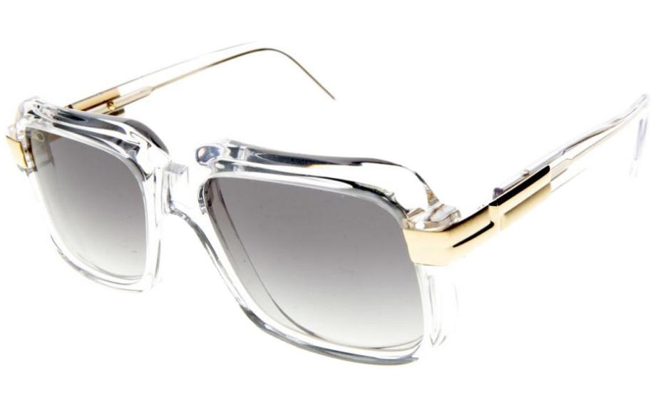 fd275ea4179c In Stock. Frame  Translucent crystal with gold detail. Lens  Graduated  grey. Bestseller. Sunglasses. Cazal ...